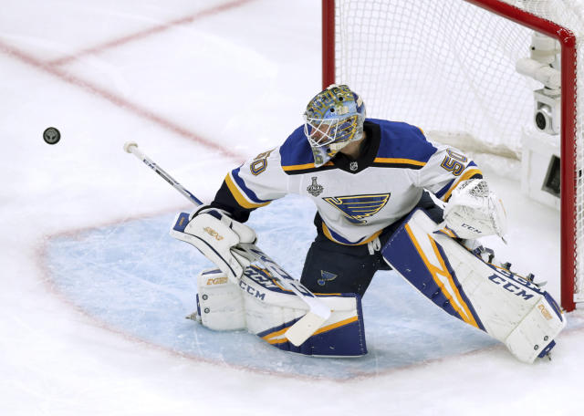 St. Louis Blues goaltender Jordan Binnington turns the puck away during the first period in Game 5 of the NHL hockey Stanley Cup Final against the Boston Bruins, Thursday, June 6, 2019, in Boston. (AP Photo/Charles Krupa)