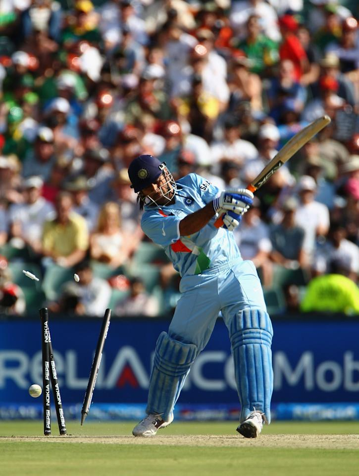 JOHANNESBURG, SOUTH AFRICA - SEPTEMBER 24: Mahendra Singh Dhoni of India is bowled out during the Twenty20 Championship Final match between Pakistan and India at The Wanderers Stadium on September 24, 2007 in Johannesburg, South Africa.  (Photo by Tom Shaw/Getty Images)