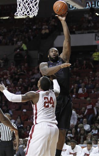 Kansas State forward Thomas Gipson (42) shoots in front of Oklahoma forward Romero Osby (24) during the first half of an NCAA college basketball game in Norman, Okla., Saturday, Feb. 2, 2013. (AP Photo/Alonzo Adams)