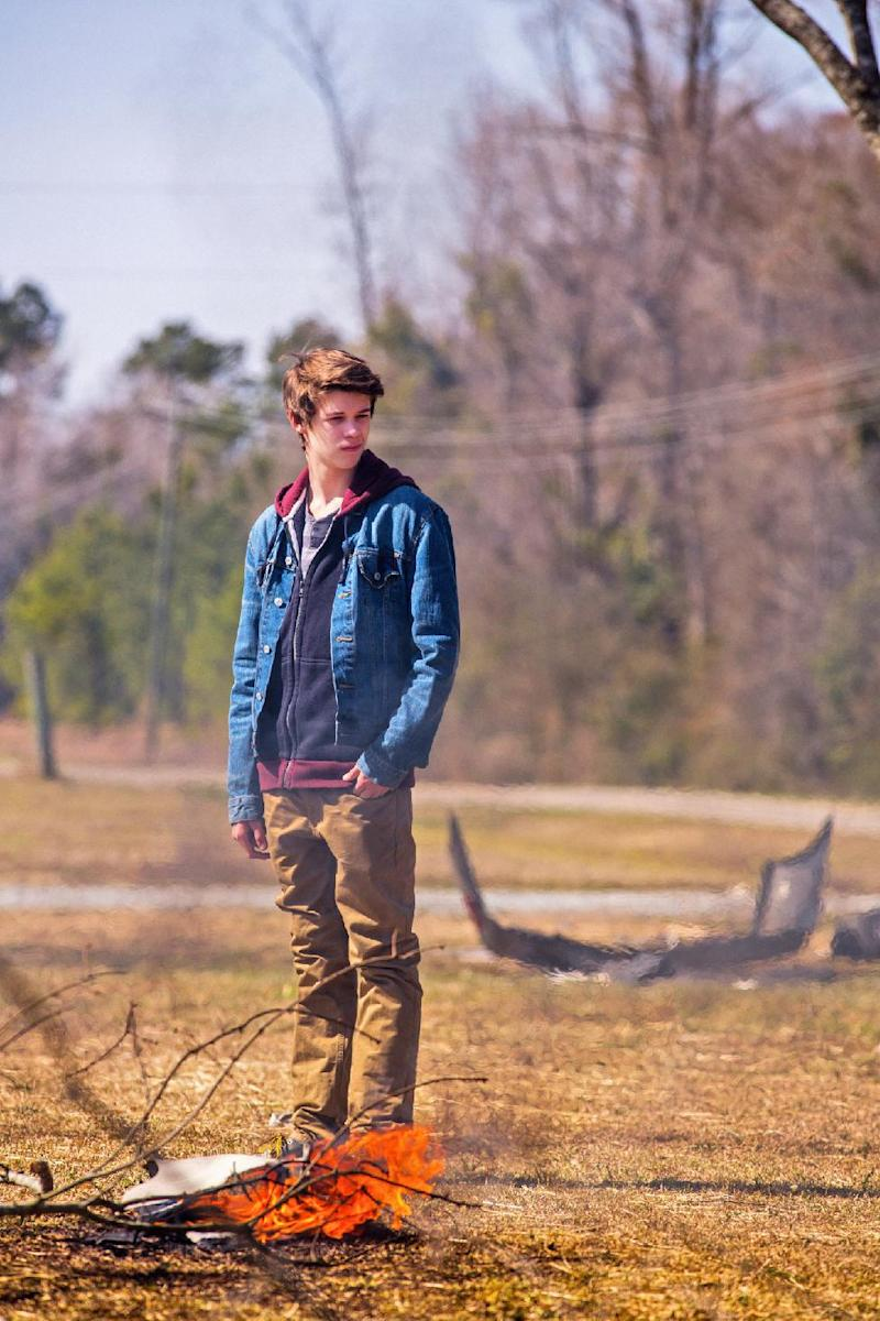 "This undated publicity photo released by CBS Entertainment shows Colin Ford, as Joe, in a scene from the pilot episode of the TV series ""Under the Dome,"" premiering Monday, June 24, 2013 at 10 p.m. EST on the CBS Television Network. The series is based on Stephen King's bestselling novel. (AP Photo/CBS Entertainment, Michael Tackett)"