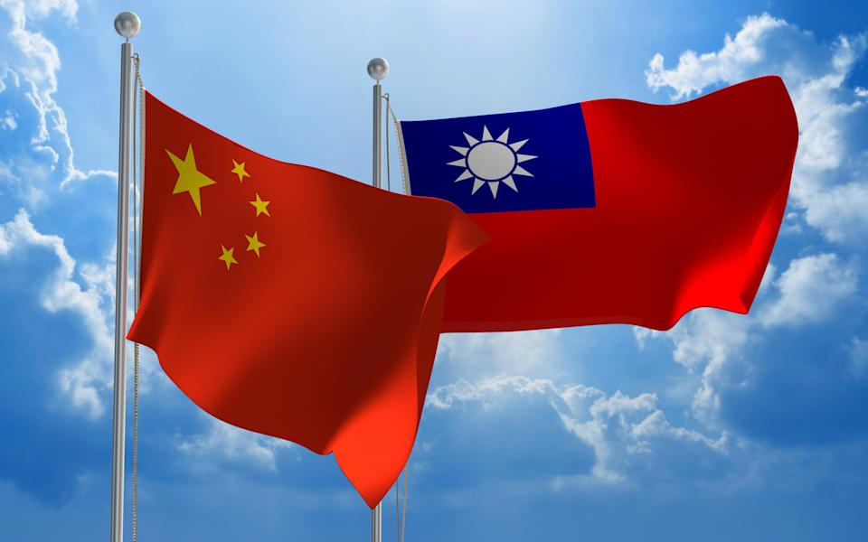 Flags from China and Taiwan flying side by side for important talks.