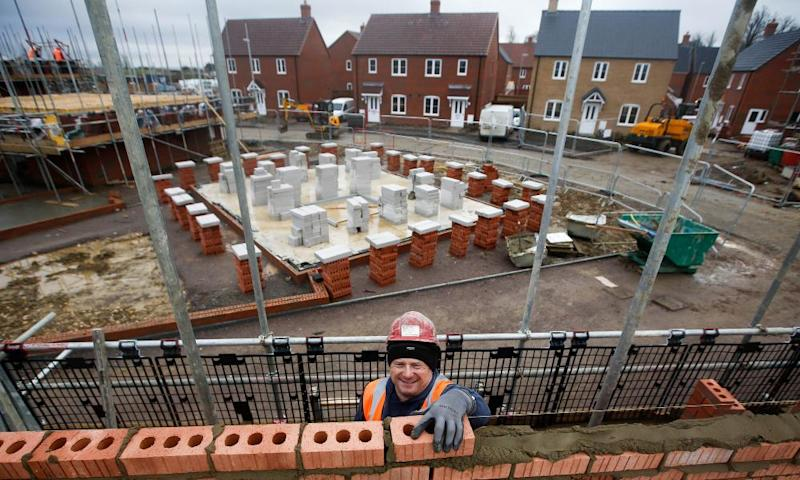 A construction worker lays bricks at a Persimmon residential property construction site in Cranfield.