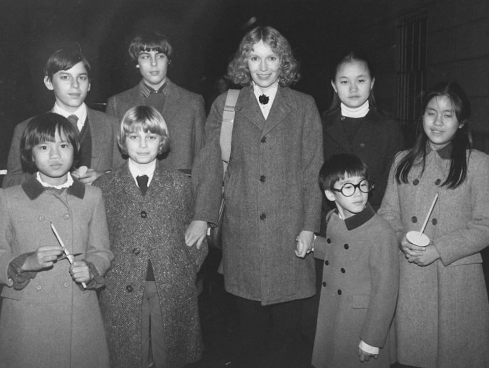 Actress Mia Farrow w. her children (back row L-R) Matthew, Sascha, Soon-Yi; (front row L-R) Daisy, Fletcher, Moses and Lark; on their way to New Year's Eve Mass.  (Photo by David Mcgough/DMI/The LIFE Picture Collection via Getty Images)