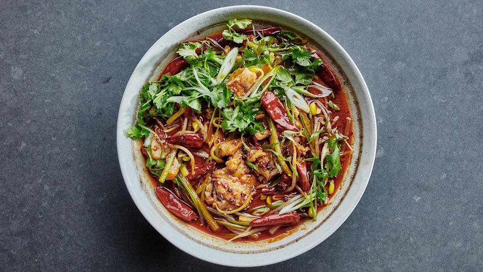 "The flavors of this fish are out of control—super spicy, super intense, super delicious. This recipe moves fast, though, so stay on top of it by prepping and lining up your ingredients before you start cooking. This recipe is from Taiwanese-American cook Lisa Cheng Smith's spectacular Lunar New Year feast. <a href=""https://bonappetit.com/gallery/lunar-new-year-menu-lisa-cheng-smith"" rel=""nofollow noopener"" target=""_blank"" data-ylk=""slk:Find the rest of her menu here"" class=""link rapid-noclick-resp"">Find the rest of her menu here</a>. <a href=""https://www.bonappetit.com/recipe/sichuan-boiled-fish?mbid=synd_yahoo_rss"" rel=""nofollow noopener"" target=""_blank"" data-ylk=""slk:See recipe."" class=""link rapid-noclick-resp"">See recipe.</a>"
