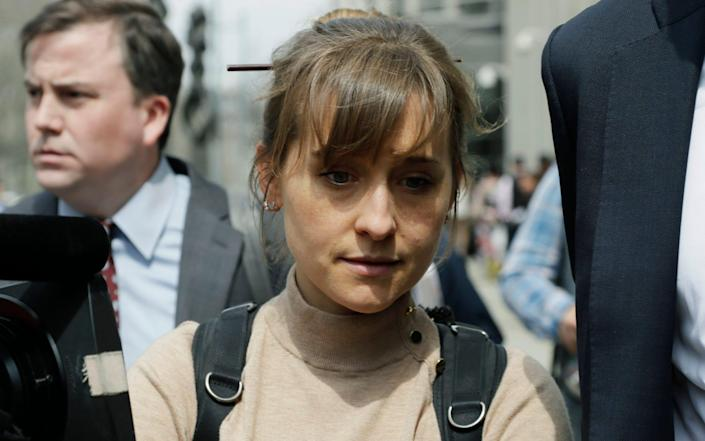 Allison Mack pleaded guilty to charges she manipulated women into becoming sex slaves - AP Photo/Mark Lennihan, File
