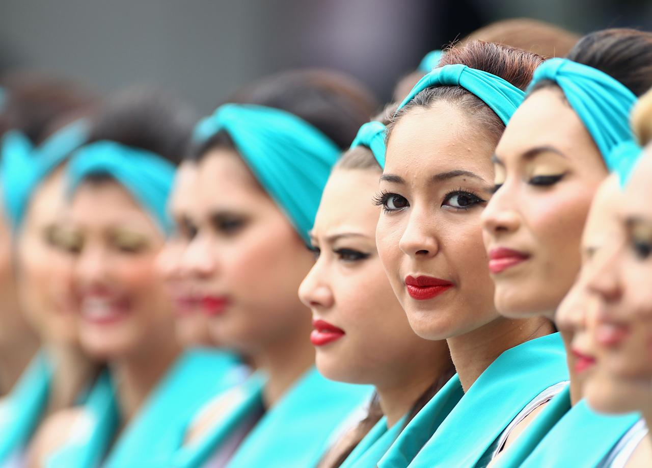 KUALA LUMPUR, MALAYSIA - MARCH 25:  Grid girls line up at the drivers parade before the Malaysian Formula One Grand Prix at the Sepang Circuit on March 25, 2012 in Kuala Lumpur, Malaysia.  (Photo by Clive Mason/Getty Images)