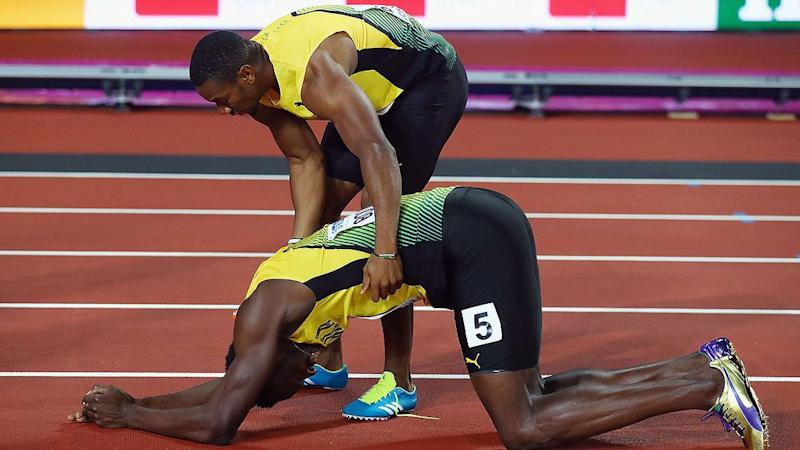 Blake consoles an injured Bolt. Pic: Getty
