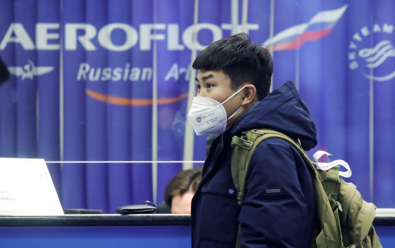 FILE PHOTO: A passenger wears a mask at Moscow's Sheremetyevo Airport