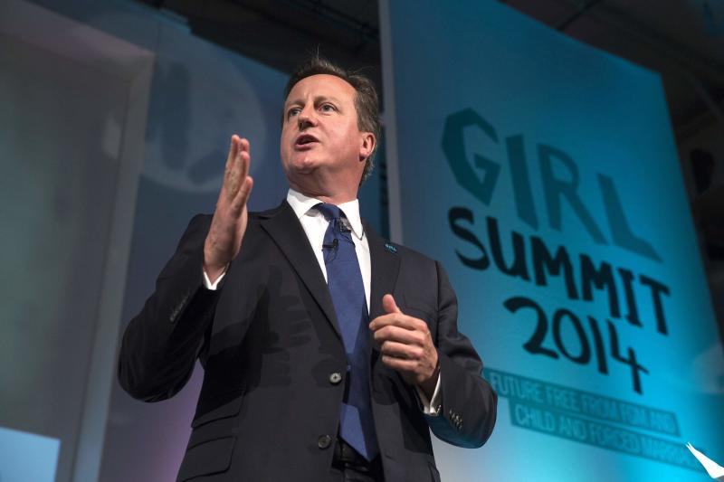 Britain's Prime Minister David Cameron speaks at the 'Girl Summit 2014' at the Walworth Academy in London July 22, 2014. Britain is to make it compulsory for teachers and health workers to report cases of female genital mutilation (FGM), Prime Minister David Cameron said on Tuesday.