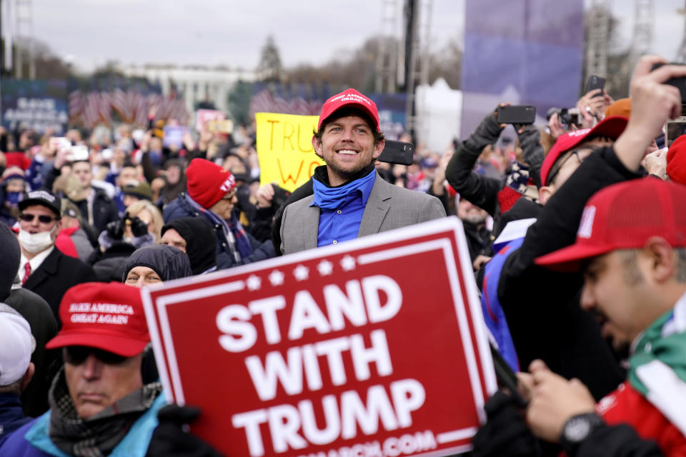 People attend a rally in support of President Donald Trump, Wednesday, Jan. 6, 2021, in Washington. (AP Photo/Evan Vucci)