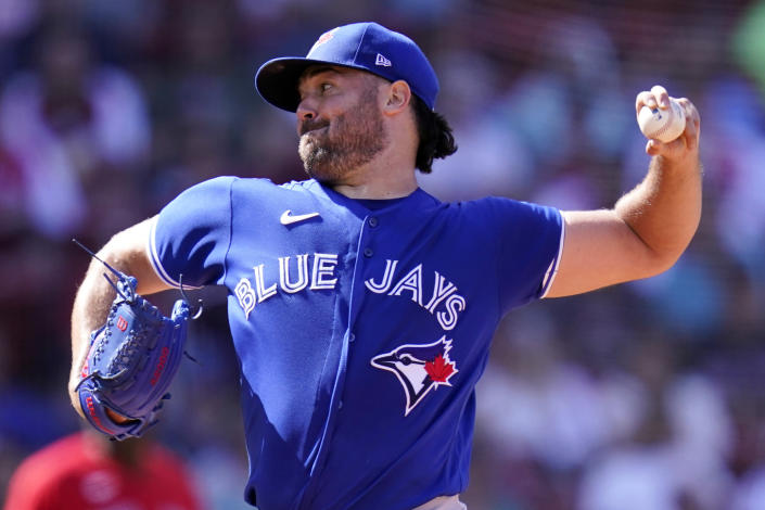 Toronto Blue Jays starting pitcher Robbie Ray delivers during the fourth inning of a baseball game against the Boston Red Sox at Fenway Park, Wednesday, July 28, 2021, in Boston. (AP Photo/Charles Krupa)