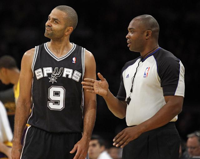 San Antonio Spurs guard Tony Parker (9), of France, listens to referee Courtney Kirkland during the first quarter of the Spurs' NBA basketball game against the Los Angeles Lakers on Friday, Nov. 1, 2013, in Los Angeles. (AP Photo/Alex Gallardo)