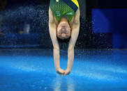 Esther Qin of Australia competes in women's diving 3m springboard preliminary at the Tokyo Aquatics Centre at the 2020 Summer Olympics, Friday, July 30, 2021, in Tokyo, Japan. (AP Photo/Dmitri Lovetsky)