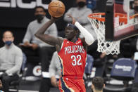 New Orleans Pelicans forward Wenyen Gabriel (32) looks to pass the ball during the first half of the team's NBA basketball game against the Charlotte Hornets on Sunday, May 9, 2021, in Charlotte, N.C.. (AP Photo/Brian Westerholt)