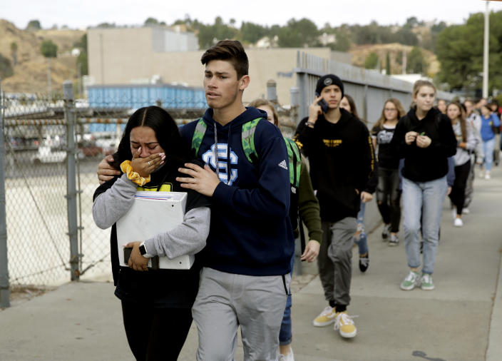 Students are escorted out of Saugus High School after reports of a shooting on Nov. 14, 2019, in Santa Clarita, Calif. (Photo: Marcio Jose Sanchez/AP)