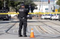 Police secure the scene of a mass shooting in San Jose