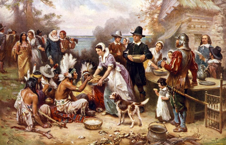 "The ""myth of Thanksgiving"" tells the tale of settlers and Native Americans amicably sharing a meal, erasing realities of exploitation and genocide. (Photo by: Universal History Archive/UIG via Getty images)"