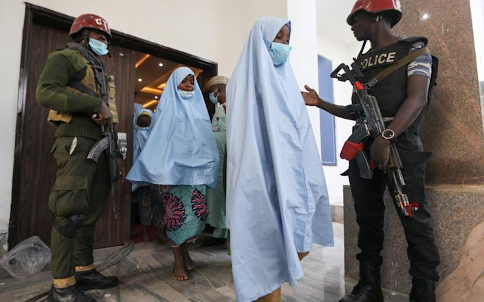 The girls were sent for a medical check-up after being released - REUTERS/Afolabi Sotunde
