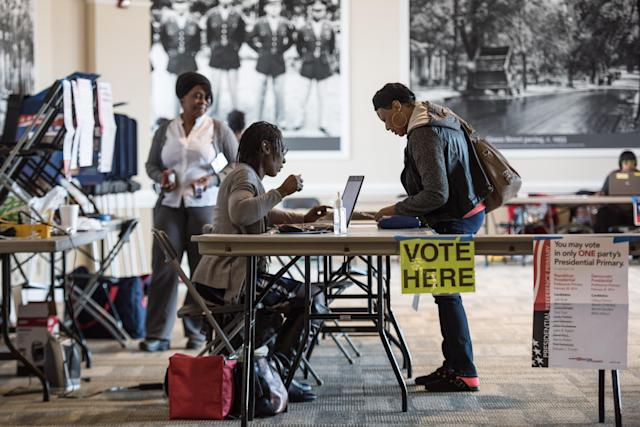 Jennifer Robison, right, signs in to vote in the South Carolina Democratic presidential primary in February 2016 at the Prince of Orange Mall in Orangeburg, S.C. (Photo: Sean Rayford/Getty Images)