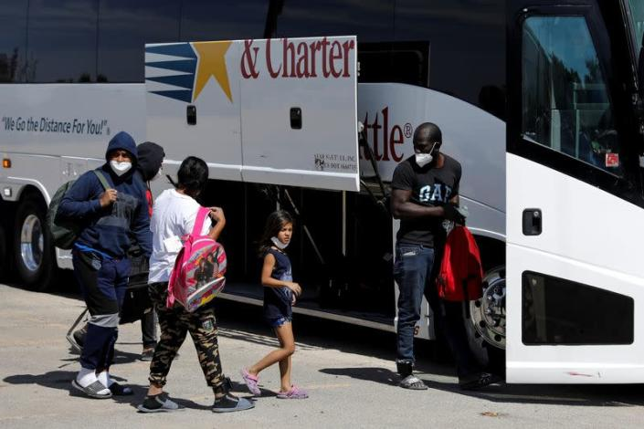 Migrants seeking asylum in the U.S. board a bus to Houston from Val Verde Border Humanitarian Coalition after being released from U.S. Customs and Border Protection, in Del Rio