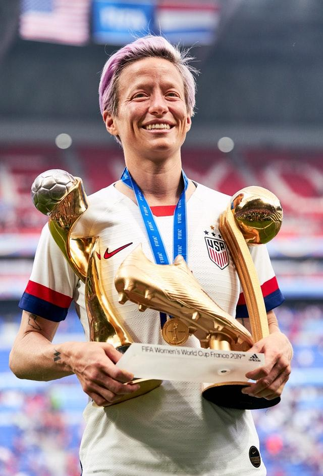 USA's Megan Rapinoe celebrates with her adidas Golden Boot award, adidas Golden Ball award, and Fifa Women's World Cup Trophy after the final (PA)