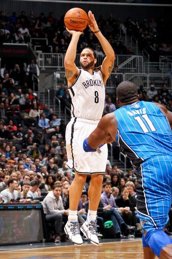 BROOKLYN, NY - JANUARY 28: Deron Williams #8 of the Brooklyn Nets shoots against Glen Davis #11 of the Orlando Magic on January 28, 2013 at the Barclays Center in the Brooklyn borough of New York City. (Photo by Nathaniel S. Butler/NBAE via Getty Images)