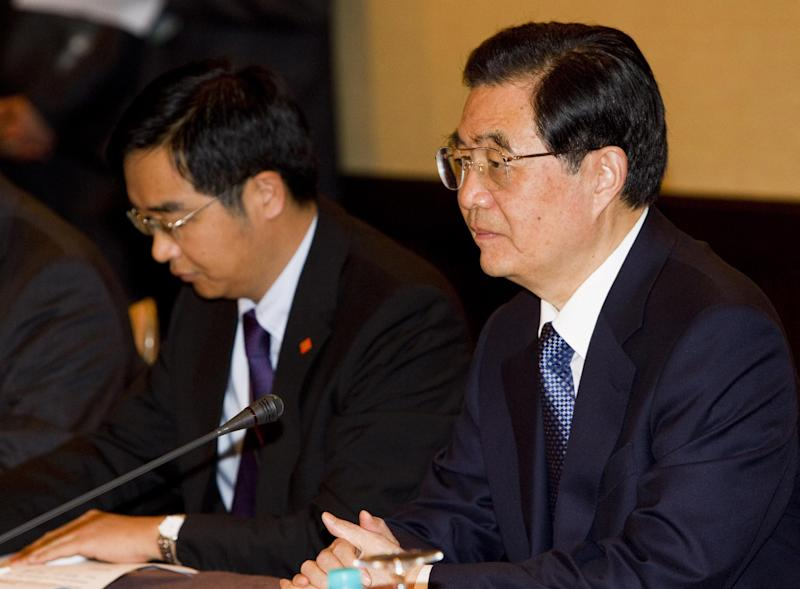 President Hu Jintao, right, President of the People's Republic of China, addresses the U.S. APEC Business Coalition during a meeting at the Sheraton Waikiki, Thursday, Nov. 10, 2011  in Honolulu.  (AP Photo/ Marco Garcia)