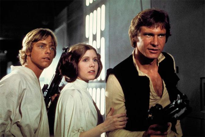 Mark Hamill, Carrie Fisher, and Harrison Ford in <em>Star Wars.</em> (Photo: Lucasfilm)