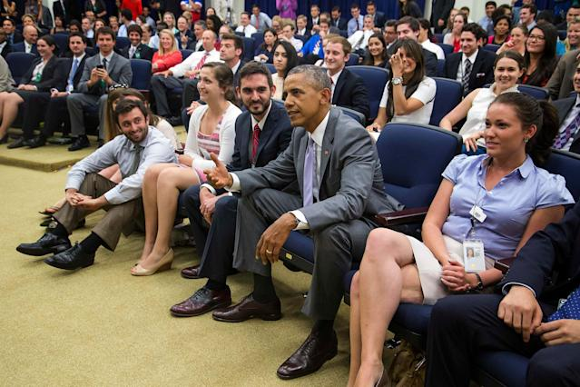 U.S. President Barack Obama (C) joins a staff viewing party to watch the World Cup soccer match between the U.S. and Belgium, in an auditorium at the Eisenhower Executive Office Building in Washington July 1, 2014. REUTERS/Jonathan Ernst (UNITED STATES - Tags: POLITICS SPORT SOCCER WORLD CUP)
