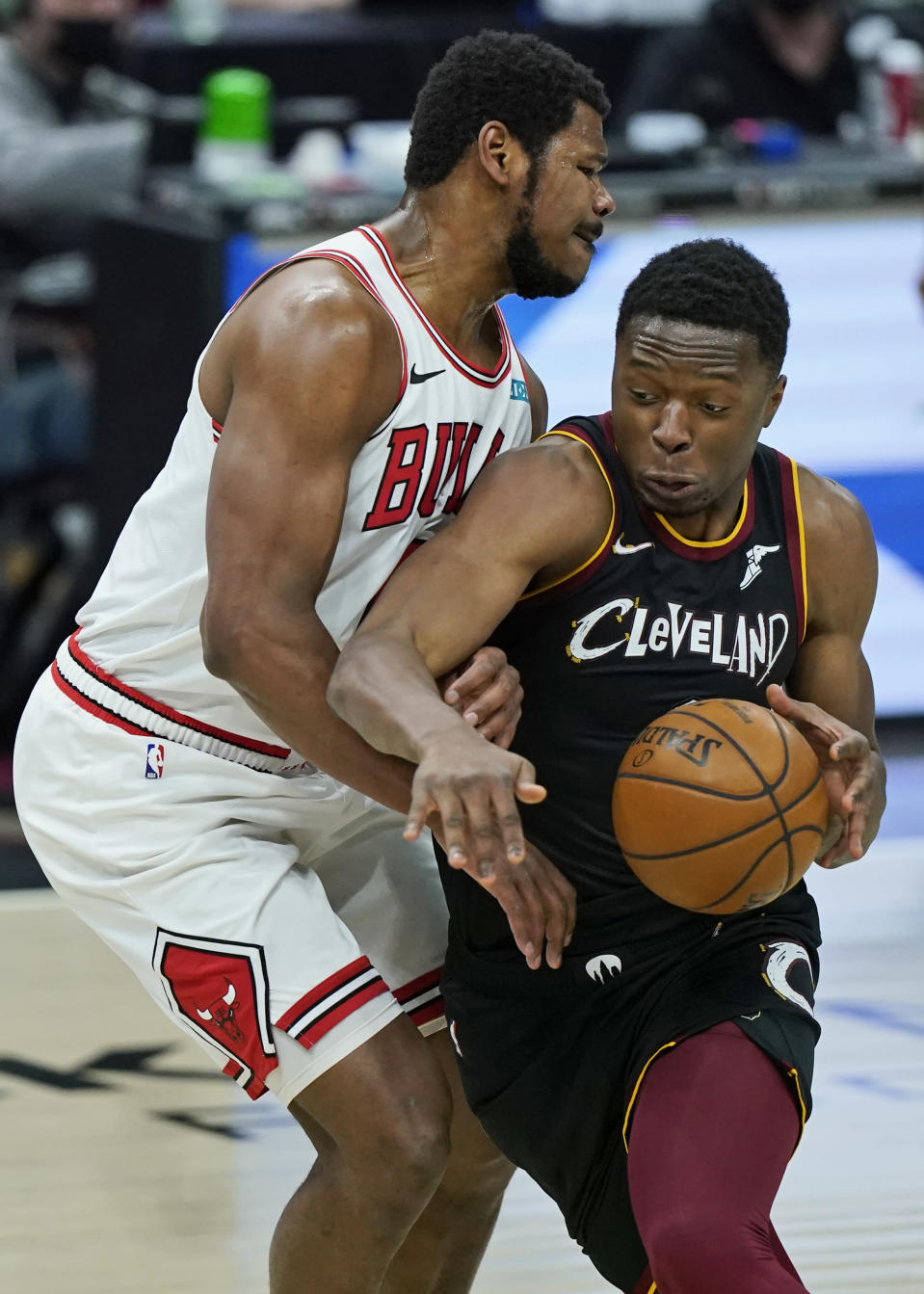 Cleveland Cavaliers' Mfiondu Kabengele, right, drives past Chicago Bulls' Cristiano Felicio during the second half of an NBA basketball game, Wednesday, April 21, 2021, in Cleveland. (AP Photo/Tony Dejak)