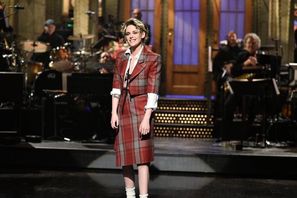 For her second time hosting <em>Saturday Night Live</em>, K-Stew paired a red plaid skirt suit with ankle socks. Instead of a shirt, she opted for a sheer black bra.
