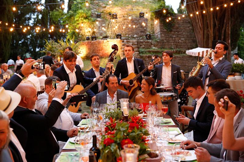 """They roved from table to table taking requests and performing songs like """"Americano"""" to set the mood."""
