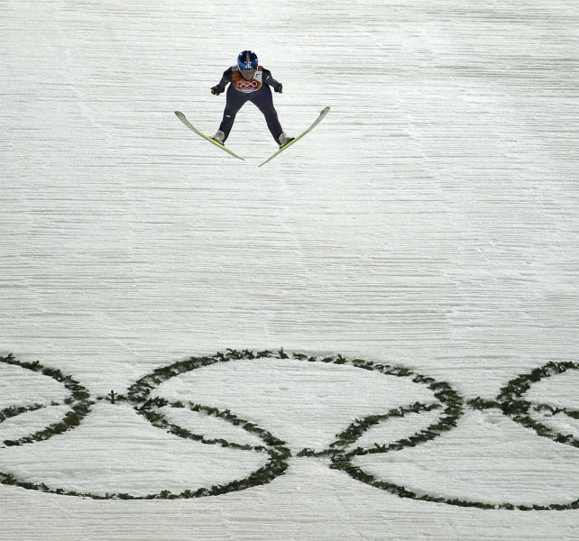 Germany's Carina Vogt jumps over the Olympic Rings on her second run during the women's normal hill ski jumping final at the 2014 Winter Olympics, Tuesday, Feb. 11, 2014, in Krasnaya Polyana, Russia. (AP Photo/Charlie Riedel)
