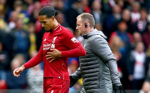 Liverpool's Virgil van Dijk leaves the pitch with an injury during the Premier League match at Anfield - Credit: Dave Thompson/PA