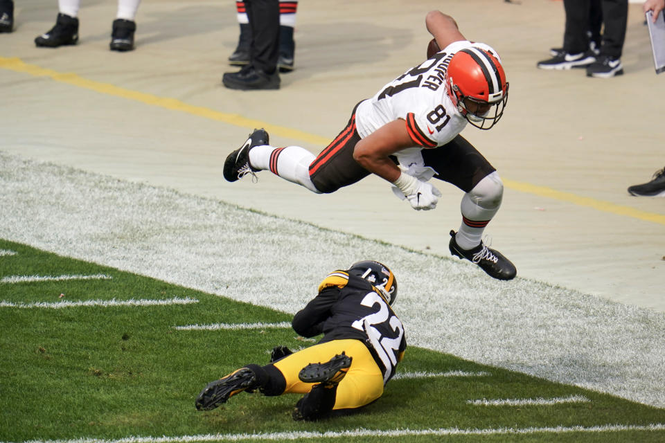 Cleveland Browns tight end Austin Hooper (81) hurdles over Pittsburgh Steelers cornerback Steven Nelson (22) while trying for more yards during the first half of an NFL football game, Sunday, Oct. 18, 2020, in Pittsburgh. (AP Photo/Gene J. Puskar)