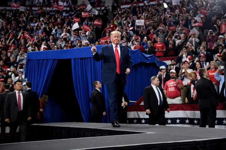 """President Donald Trump told a political rally in Hershey, Pennsylvania that the charges against him were """"impeachment light"""". (AFP Photo/Brendan Smialowski)"""