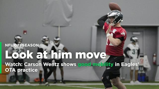 The Super Bowl champion Philadelphia Eagles are holding their first day of on-field organized team activities on Tuesday, and quarterback Carson Wentz, who tore the ACL and LCL in his left knee on December 10 against the Los Angeles Rams, is in uniform with his teammates.