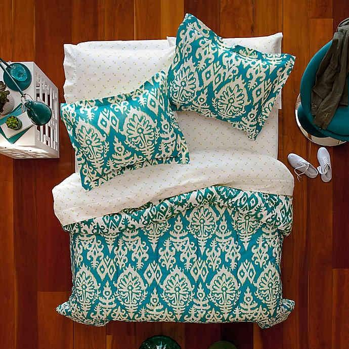 """<p>The festive print on the <a href=""""https://www.popsugar.com/buy/%C3%A9ropstale-Katya-Reversible-Comforter-Set-474195?p_name=A%C3%A9ropstale%20Katya%20Reversible%20Comforter%20Set&retailer=bedbathandbeyond.com&pid=474195&price=60&evar1=casa%3Aus&evar9=46438836&evar98=https%3A%2F%2Fwww.popsugar.com%2Ffood%2Fphoto-gallery%2F46438836%2Fimage%2F46441404%2F%C3%A9ropstale-Katya-Reversible-Comforter-Set&list1=college%2Cbedding&prop13=api&pdata=1"""" rel=""""nofollow"""" data-shoppable-link=""""1"""" target=""""_blank"""" class=""""ga-track"""" data-ga-category=""""Related"""" data-ga-label=""""http://www.bedbathandbeyond.com/store/product/a-eacute-ropostale-katya-7-piece-reversible-comforter-set/3295442?categoryId=12498&amp;fromCollege=true"""" data-ga-action=""""In-Line Links"""">Aéropstale Katya Reversible Comforter Set</a> ($60) can brighten up any space, but if you get sick of it, reverse it to its subtle medallion motif side. </p>"""