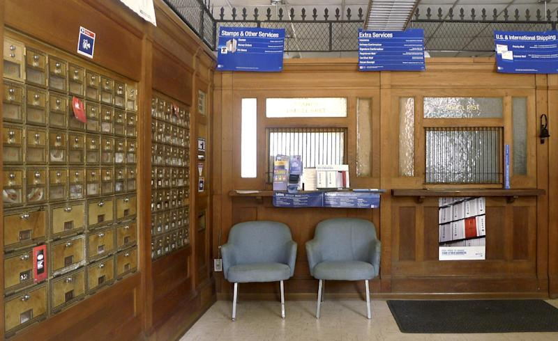 This Saturday, Sept. 17, 2011 photo shows the local post office in Markham, Va. The financially struggling U.S. Postal Service sought Wednesday, May 9, 2012 to tamp down concern over wide-scale cuts, revealing it will seek to keep thousands of rural post offices open with shorter hours. Under the emerging strategy, no post office would be closed. But more than 13,000 rural mail facilities could see reduced operations of between two and six hours. (AP Photo/J. Scott Applewhite)