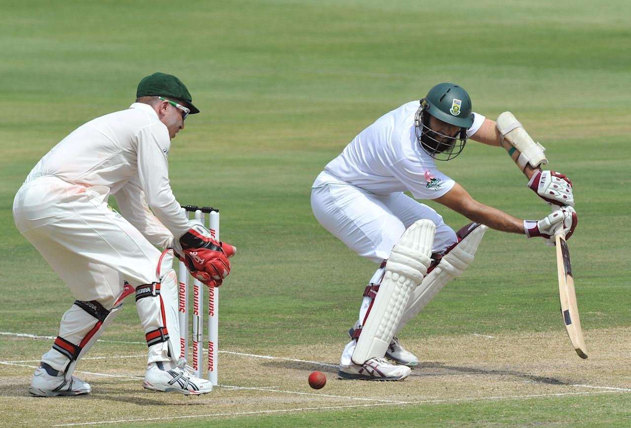 JOHANNESBURG, SOUTH AFRICA - NOVEMBER 19:  Hashim Amla of South Africa plays a late cut during the third day of the 2nd Test match between South Africa and Australia at Bidvest Wanderers on November 19, 2011 in Johannesburg, South Africa. (Photo by Duif du Toit / Gallo Images/Getty Images)