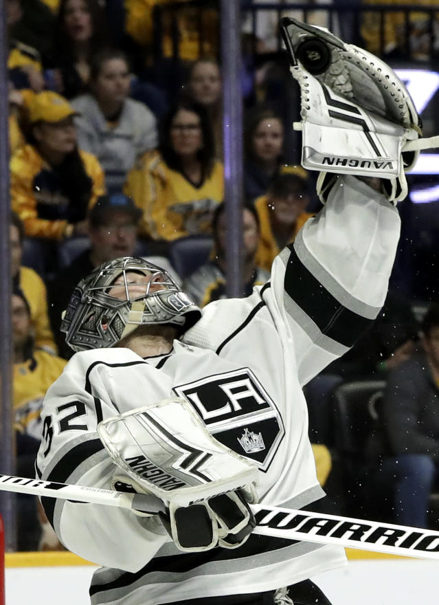 Los Angeles Kings goaltender Jonathan Quick reaches for the puck during the second period of the team's NHL hockey game against the Nashville Predators on Thursday, Feb. 21, 2019, in Nashville, Tenn. (AP Photo/Mark Humphrey)