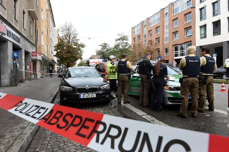 German police guard a security perimeter near Rosenheimer Square in Munich, on October 21, 2017