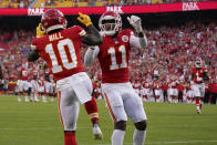 Kansas City Chiefs wide receiver Tyreek Hill (10) is congratulated by teammate wide receiver Demarcus Robinson (11) after scoring during the first half of an NFL football game against the Minnesota Vikings Friday, Aug. 27, 2021, in Kansas City, Mo. (AP Photo/Charlie Riedel)