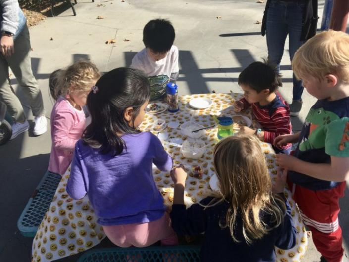 a group of small children at a picnic playdate