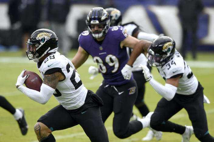 Jacksonville Jaguars safety Josh Jones, left, runs with the ball after intercepting a pass from Baltimore Ravens quarterback Lamar Jackson, not visible, prior to an NFL football game, Sunday, Dec. 20, 2020, in Baltimore. (AP Photo/Gail Burton)