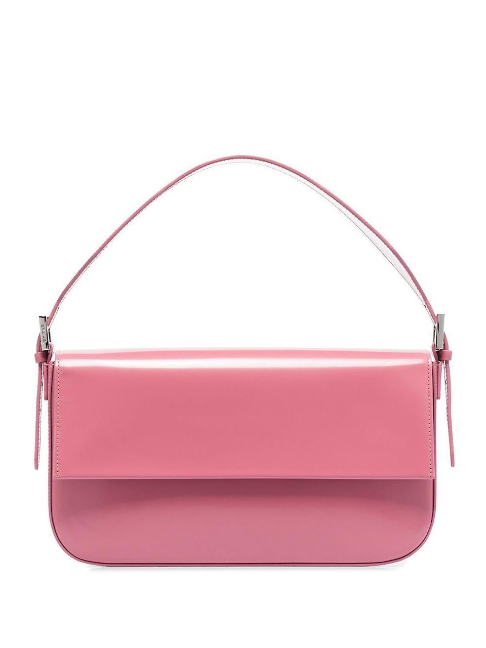"""<p><strong>BY FAR</strong></p><p>farfetch.com</p><p><strong>$555.00</strong></p><p><a href=""""https://go.redirectingat.com?id=74968X1596630&url=https%3A%2F%2Fwww.farfetch.com%2Fshopping%2Fwomen%2Fby-far-manu-leather-shoulder-bag-item-15597252.aspx&sref=https%3A%2F%2Fwww.harpersbazaar.com%2Ffashion%2Fg34046218%2Fspring-2021-bag-trends%2F"""" rel=""""nofollow noopener"""" target=""""_blank"""" data-ylk=""""slk:Shop Now"""" class=""""link rapid-noclick-resp"""">Shop Now</a></p><p>The shoulder bag is here to stay, have fun with it.</p>"""