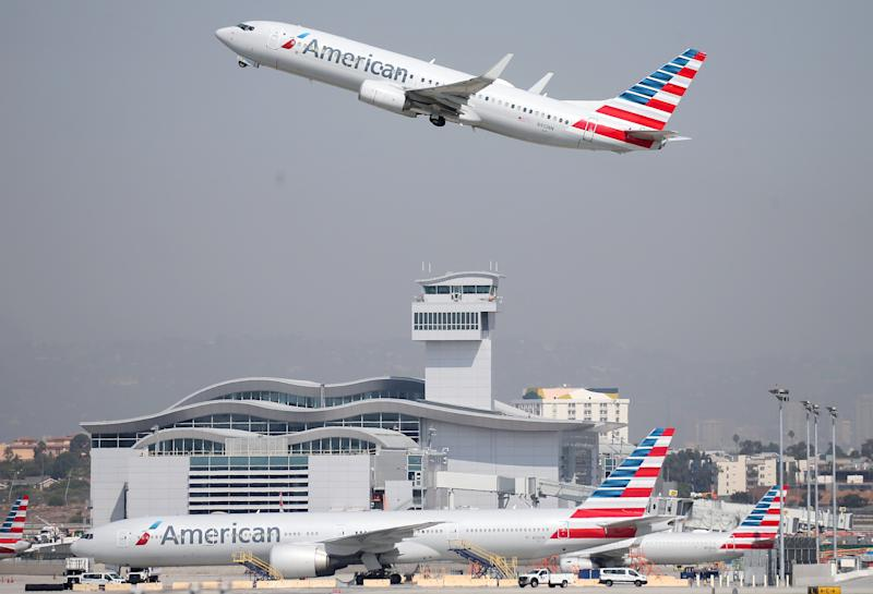 YouTuber kicked off American Airlines flight after hiding in friend's business class footwell