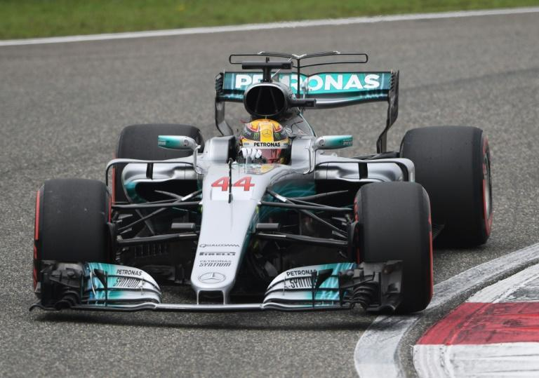 Lewis Hamilton, a three-time Formula One world champion, pipped Sebastian Vettel by two tenths of a second to grab pole in Shanghai