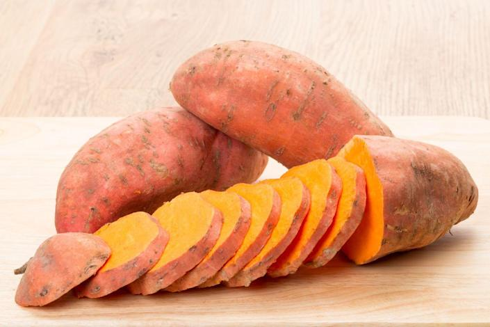 """<p>""""<a href=""""https://www.prevention.com/food-nutrition/healthy-eating/a23285646/sweet-potato-nutrition/"""" rel=""""nofollow noopener"""" target=""""_blank"""" data-ylk=""""slk:Sweet potatoes"""" class=""""link rapid-noclick-resp"""">Sweet potatoes</a> are a great source of fiber and an array of vitamins and minerals including vitamin C, iron, and B vitamins,"""" says Matthews. """"They also contain beta carotene, which gives it the bright orange hue. Unlike the white potato, an 80-gram portion of sweet potato counts towards one of your daily vegetable servings.""""</p>"""