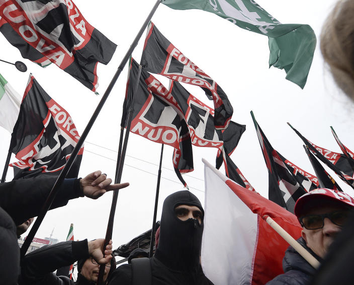 Members of the Italian Forza Nouva walk in the annual March of Independence organized by Polish far right activists to celebrate 100 years of Poland's independence. in Warsaw, Poland, Sunday, Nov. 11, 2018.(AP Photo/Czarek Sokolowski)